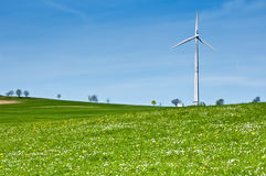 Wind Turbine in Spring Meadow Royalty Free Stock Images