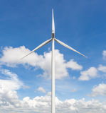 The wind turbine standalone with cloudy blue sky background in t Royalty Free Stock Photo