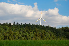 A wind turbine stands in the forest in Germany's Eifel region. A wind rotor in the forest in Germany's Eifel region Stock Images