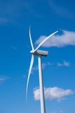 Wind turbine in strong wind Stock Photo