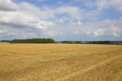 Wind turbine and stubble field Stock Photography