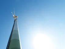 Wind turbine and sun Stock Images