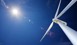 Wind Turbine and sun from below. Wind Turbine from below with sun creating lens flare Royalty Free Stock Photos