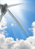Wind turbine, sun and blue sky Royalty Free Stock Photos