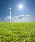 Wind turbine with sunny sky stock photography