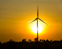 Wind turbine by sunrise Royalty Free Stock Images