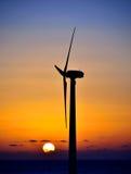 Wind turbine at sunrise Royalty Free Stock Photos