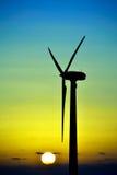 Wind turbine at sunrise Stock Images