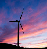 Wind turbine sunrise, dawn. Clean energy background. Stock Photography