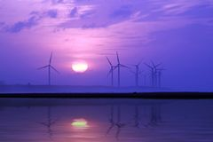 Wind Turbine with sunset. For background Royalty Free Stock Photography