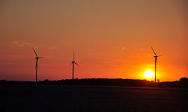 Wind turbine during sunset Stock Photography