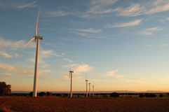 Wind turbine at sunset Stock Photography