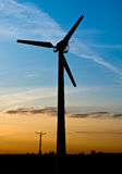 Wind turbine on sunset. And blue sky Royalty Free Stock Photos