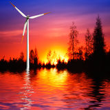 Wind turbine at sunset Stock Photo