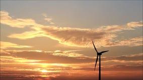 Wind turbine at sunset stock video footage
