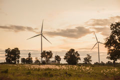 Wind turbine in sunset Royalty Free Stock Photo