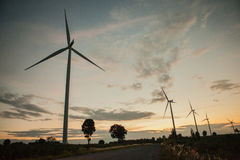 Wind turbine in sunset Royalty Free Stock Images