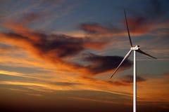 Wind turbine and sunset sky Stock Image