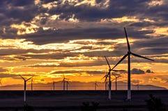 Wind turbine at sunset stock photography