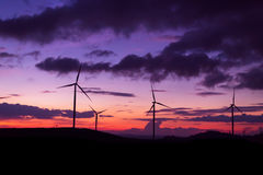 Wind turbine sunset time Royalty Free Stock Images