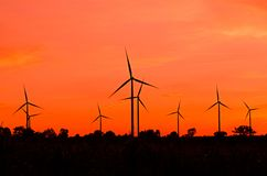 Wind turbine at sunset Royalty Free Stock Photos
