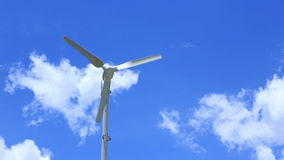 Wind turbine of technology clean energy environmental in blue sky stock footage