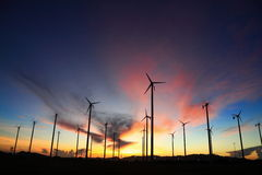 Wind turbine in thailand. Silhouette of wind power station on sunrise Stock Photos