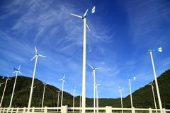 Wind turbine in thailand. Windmills against a blue sky and clouds, alternative energy source Royalty Free Stock Photo