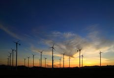 Wind turbine in thailand. Silhouette of wind power station on sunrise Stock Photography