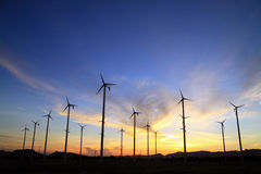Wind turbine in thailand. Silhouette of wind power station on sunrise Royalty Free Stock Photos