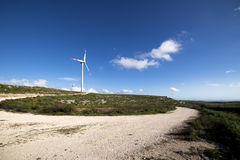 Wind turbine to generate electricity. Symbol of renewable energy Royalty Free Stock Image