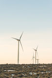 Wind turbine tower with sunset sky background in counter side, winter season.. Royalty Free Stock Photos