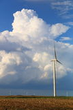 Wind turbine. With towering cumulus cloud in the background Stock Photos