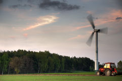 Wind turbine and tractor Royalty Free Stock Photos