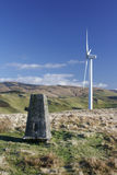 Wind turbine with trig point Stock Photo