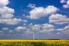 Wind Turbine under a blue, cloud-strewn sky Stock Photo
