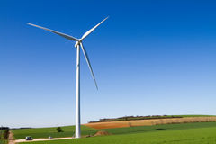 Wind turbine under clear blue sky Stock Image