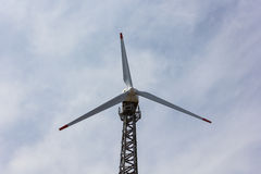 Wind turbine. With a white clouds Stock Photo