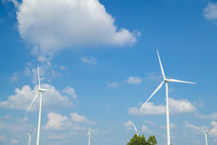 Wind Turbine in wind farm with sky Royalty Free Stock Image
