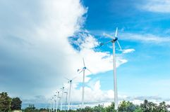 Wind turbine or windmill generating electricity. Wind turbine or windmill generating electricity on blue sky background royalty free stock images
