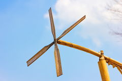 Wind turbine. Wood wind turbine on blue sky, traditional of thailand, asian Stock Photos