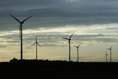 Wind turbines. Silhouettes of wind turbines in europe Royalty Free Stock Photography