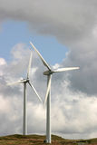 Wind Turbines. Two turbines against a cloudy sky Stock Photo