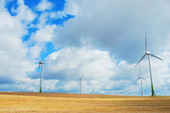 Wind turbines. In a field on a cloudy day Royalty Free Stock Photo