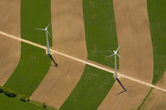 Wind turbines. Aerial view of two wind turbines during late spring Stock Photos