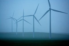 Wind Turbines. Group of wind turbines at a wind farm on a very rainy day Royalty Free Stock Photo