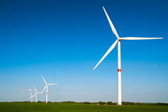Wind turbines. A row of wind turbines in a field royalty free stock photography