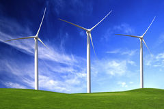 Wind Turbines. Clean energy being generated by a windmills park royalty free stock image