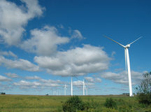 Wind turbines. Wind mills against a blue sky and clouds Stock Photos
