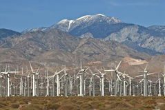 Wind Turbines. Wind Turbine farm located on California desert surrounded by mountains Royalty Free Stock Photos